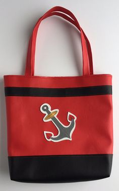 You'll be stylish on land or at sea with this sturdy red and black vinyl tote. Bag measures across by tall and features an embroidered anchor on front and back, as well as red and orange anchor print lining. Reusable Tote Bags, Trending Outfits, Anchors, Unique Jewelry, Handmade Gifts, My Style, Cats, Goodies, Smile