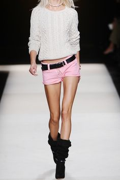 Isabel Marant shorts have belt loops, a lace-up self-tie front, five pockets and a button-fastening waist. 97% cotton, 3% elastane; lining: 100% cotton. Machine wash cold inside out to avoid color transfer. Isabel Marant's thigh-skimming stretch-denim shorts in a playful pink hue are a must-have straight from the SS11 show.    Pink stretch-denim low-rise shorts with cut-off raw-edged cuffs. Team this raw-edged pair with bronzed legs and slouchy boots to emulate the runway look.