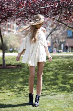 White dress off the shoulders, fairy like, edgy boots, flowers in hair