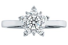 Diamond cluster ring with 18k white gold petals by Hearts on Fire.