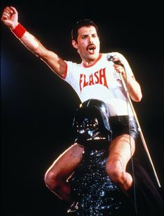 - Your favorite singer might be cool, but are they riding on Darth Vader's shoulders while wearing a Flash Gordon t-shirt cool?