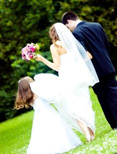 such a cute job for the flower girl to do during pictures with the bride and groom! And the lace!