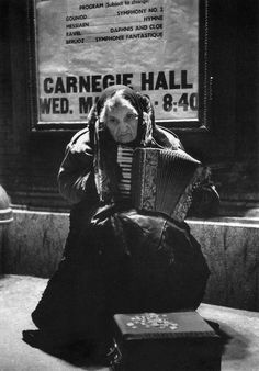 Alfred Eisenstaedt - Carnegie Hall, New York 1960. 80-year-old street musician Lylah Tiffany playing the accordion and begging outside Carnegie Hall where she has rented a studio apt. there for the last 12 years and sustained herself by working the street. °