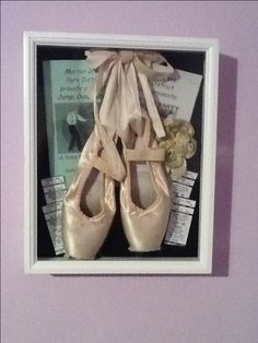 I put my first pair of pointe shoes along with ticket stubs, programs and my hair piece in a shadow box. I love how it turned out.