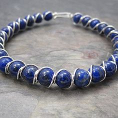 Lapis Lazuli Beaded Sterling Silver Wire Wrapped Bracelet. $40.00, via Etsy.