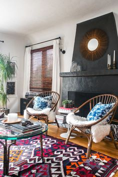 Rattan chairs from Urban Outfitters sit in front of a faux tile fireplace Brian and Merisa designed themselves.
