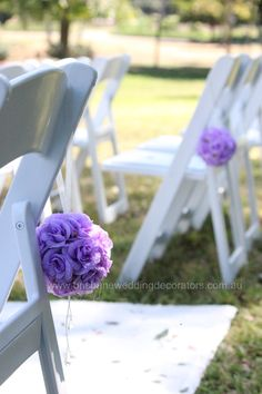 Fresh white Americana wedding chairs with lilac flower kissing balls. Ceremony set up by Brisbane Wedding Decorators www.brisbaneweddingdecorators.com.au