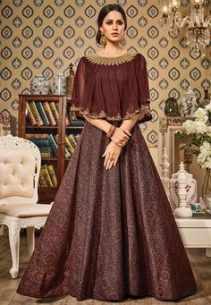 Take a look at this #offbeat piece in #rustic #red #hue. Incorporated with an embellished #Cape, this #Abaya #Style Suit in #Digital #Print is #stunning- absolutely one of its kind. If you got the chutzpah, go for it! Product Code: KQU705