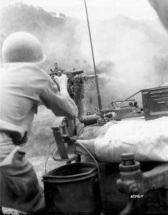 Sgt. Douglas D. Tompkins of Jud, North Dakota, Tank Company, 5th RCT, 24th U.S. Infantry Division, fires a .50 caliber machine gun at Communist-held positions during an assault against the Chinese Communist forces along the east central front, Korea.  14 July 1951.  Korea.  Signal Corps Photo #8A/FEC-51-255588