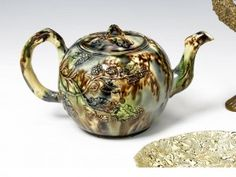 A good early Staffordshire teapot and cover of Whieldon type Circa 1750-60.