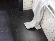 Brand-New Black Flooring - Timeless Black and White Master Bathroom Makeover on HGTV