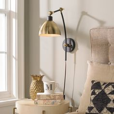 $90 plug in sconces in matte black and gold. Love the mixed finish and the fact that they're plug in so there's not a lot of work to Hardware them.