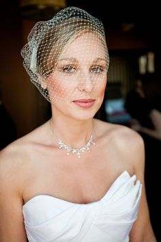 makeup and birdcage veil