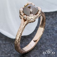 Design Your Own Unique Custom Jewelry at Green Lake Jewelry Works! Custom 14kt rose gold earthy hand carved branch and floral ring with cushion shape rose cut diamond center stone