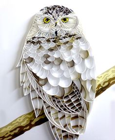 A commissioned quilling of an owl, made completely out of paper.