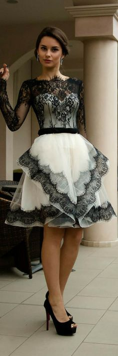 The French lace dress has long sleeves; high neckline and scalloped open back in V-shape, handmade corset on top of which is placed a layer of fantastic French lace. Black and white wedding dress, Short bridal dress with lace, Sleeved lace wedding dress, French wedding dress with sleeves from Alencon lace.  Maybe lowered like gown?