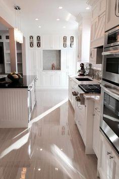 Custom White Kitchens custom white kitchen pantry. with caeserstone countertop and dove