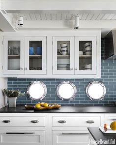 coastal kitchen with porthole windows | Frank Roop Design Interiors
