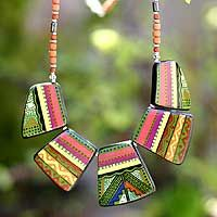 Ceramic pendant necklace, 'Sweet Princess'  Named Ñusta, the Quechua name for pre-Hispanic princesses, this necklace is youthful and lovely. Dina paints the ceramic medallions by hand. They center a strand of beads punctuated by shining Andean silver.