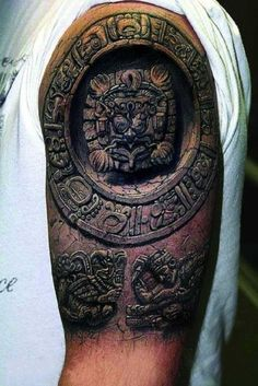 Hyperrealistic Mayan stone carving sleeve tattoo.