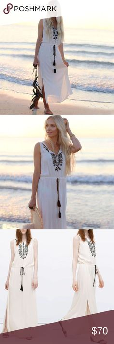 Zara Aztec Embroidered Boho Maxi Dress Look sizzling this summer in this statement maxi dress from Zara  ↠round neckline & sleeveless arms ↠aztec black embroidered detailing & an open front, fastened with buttons ↠drawstring waist with tassel detailing; can be worn tightened or left loose ↠maxi in length & sweeps the floor with slits up either side of the dress to about knee length depending on height ↠color: cream  ↠New w/o tags ↠XS; sz runs large; will fit those who normally wear sm to med…
