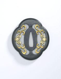 Tsuba (sword guard) with floral design  Wrought iron or steel, gilded  Centimetres: 6.9 (length), 6.2 (width)  1603 - 1867 AD  Edo period  Area of Origin: Japan  Area of Use: Japan; Asia  Prince Takamado Gallery of Japan. ROM Images,