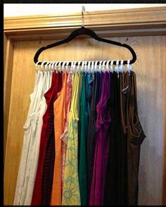 Organize tank tops with shower curtain rings