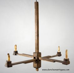 Exceedingly rare 18th century American hanging and extending carved wooden chandelier.