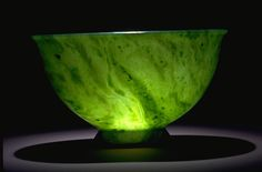 Nephrite Jade Bowl. This bowl is carved from nephrite. Nephrite crystals typically are fibrous and are interwoven to produce a tough rock. From as early as 1000 B.C. the Chinese were making weapons and ornaments from a green stone they called yu, now known in the West as nephrite. This bowl is 9 cm (3.5 in) tall.