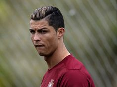 Portuguese forward Cristiano Ronaldo looks on during a training session at Praia Del Rey, near Obidos on June 5, 2013. Portugal is holding a training camp in preparation for their upcoming WC 2014 qualifyer footbal match against Russia on June 7