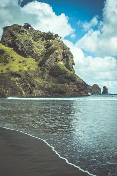 Lion Rock at Piha Beach on the west coast of Auckland New Zealand. The article contains images of black sand beaches waterfalls rainforest and surfers. Travel Images, Travel Photos, Travel Pictures, Landscape Photography, Nature Photography, North Island New Zealand, Auckland New Zealand, Family Destinations, Black Sand