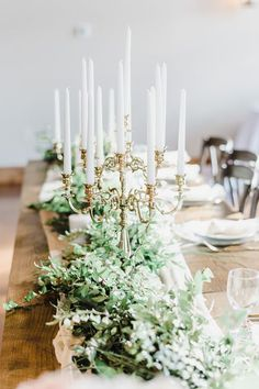 Soft, Organic and Romantic Mountain Wedding Inspiration with classic greenery and white candle stick centerpieces