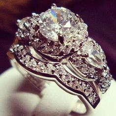 Still prefer a cushion or a princess cut, but I love the idea and the custom band to compliment an elaborate ring!