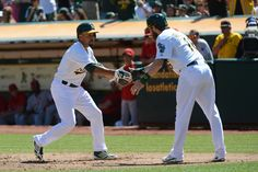 CrowdCam Hot Shot: Oakland Athletics center fielder Coco Crisp celebrates with right fielder Josh Reddick for hitting a two-run home run against the Los Angeles Angels during the third inning at O.co Coliseum. Photo by Kyle Terada