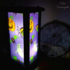 Create a fun and spooky Halloween lantern by repurposing / upcycling an outdated candle lantern from the thrift store. The secret? Cellophane treat bags!
