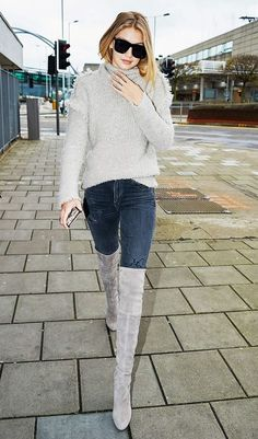 Gigi Hadid is cozy in a textured turtleneck, skinny jeans, and thigh-high suede boots - PIN Blogger