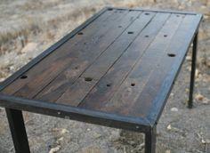 Dining table made of wood reclaimed from a battle ship.