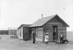 An unidentified man and two children pose in front of the office of the secretary treasurer of the Taber School District, Alberta, Canada, 1905. #Edwardian #school #1900s #vintage #Canada