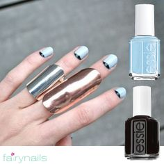 Get a unique manicure in baby blue with black details at Fairynails!