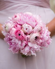 These bridesmaids carried arrangements of peonies and ranunculus
