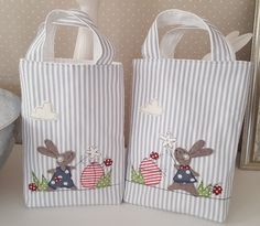 * Easter bag for filling * decorated with an Easter bunny girl, easter eggs, flowers . collecting and storing Easter eggs It is lightly padded and fully lined.Informations About *Osterbeutel zum Befüllen* verziert mit einem Osterh Easter Projects, Easter Crafts, Fabric Gift Bags, Easter Pictures, Sewing Pillows, Small Bags, Handmade Bags, Easter Bunny, Easter Eggs