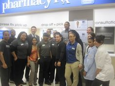 Duane Reade store employees posing with Carmelo after he arrives. #DRPowercoco