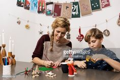 Stock Photo : Mother and son making X mas decorations
