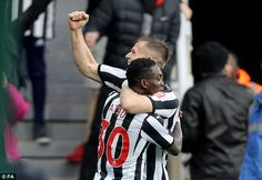 Matt Ritchie celebrates with team-mate Christian Itsu after the former Chelsea youth scored