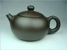 Yixing clay tea pot, formed entirely by hand in Zisha (purple clay). From the Yixing town region, China.