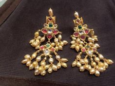 For example, every woman needs an LBD (little black dress), and a pair of pearl earrings. Pearl earrings have the wonderful ability of bein… Gold Jhumka Earrings, Jewelry Design Earrings, Gold Earrings Designs, Gold Jewellery Design, Pearl Earrings, Gold Designs, Necklace Designs, Pearl Jewelry, Beaded Necklace