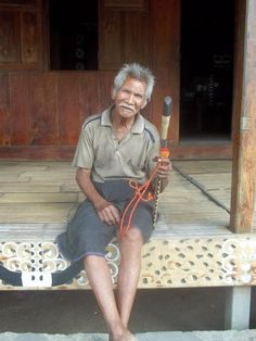 Local with traditional sword, Bena Village, Flores