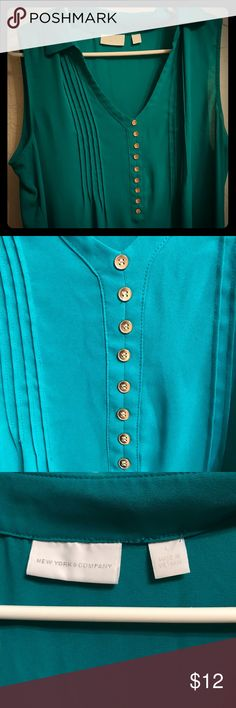 New York & Company XL Green Tank Top Good condition. Slight staining at underarm area (in last picture). Emerald green shirt with Gold buttons down the front with some pleats to the sides of the buttons. Shirt is flowy. Pet free, smoke free home. New York & Company Tops Tank Tops