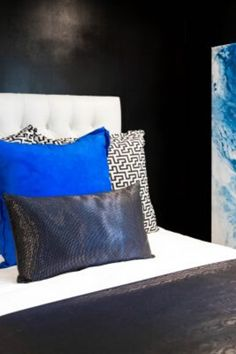 Would you consider a black color palette for your bedroom? Learn 7 unexpected ways to use black paint, black wallpaper, or black fixtures in your home decor for a chic, sophisticated look, as shown in this  bedroom accented with pops of blue pillows and art. Take your design to a new level with black wall paint or a black ceiling, as shown here. Check out the home decor and interior design projects using black that inspire us the most on Hadley Court. #blackisback #blackpaint #blackandwhite