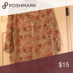 Floral blouse Semi sheer, 3/4 sleeve blouse.  Never wore Tops Blouses